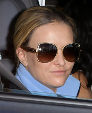 Brooke Mueller hit Taco Bell in a pair of gold-framed butterfly sunglasses.