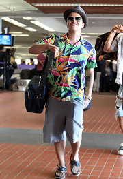 Bruno Mars arrived in Maui looking ready for a luau in his Hawaiian shirt.