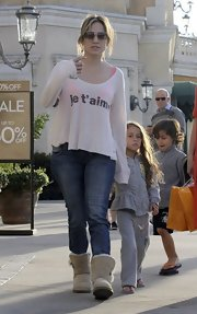 J. Lo opted for sheepskin boots while out with her kids, Max and Emme.