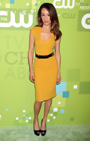 Maggie Q finished off her simple yet chic look with a pair of black platform peep-toes.
