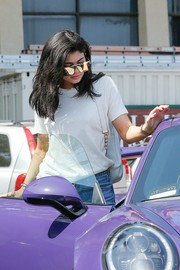 Kylie Jenner kept her eyes hidden behind a pair of mirrored shield sunglasses by Quay while out and about.