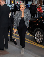 Cameron opted for a chic printed jacket with gray ankle boots.