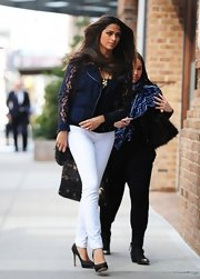 Camila Alves kept her daytime look light and bright with white skinny pants.