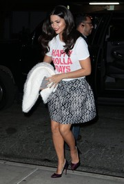 Camila Alves dolled up her casual top with a flared tribal-print mini skirt.