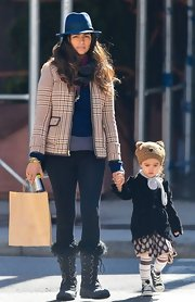 Camila Alves stepped out with her kids in NYC sporting this orange tweed jacket.