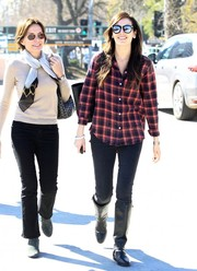 Camilla Belle rounded out her casual look with flat knee-high boots.