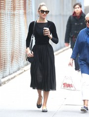 Candice Swanepoel showed off her tiny frame in a tight black wrap top while strolling in New York City.