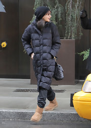Carey Mulligan kept out the cold in a long black down jacket and matching beanie.