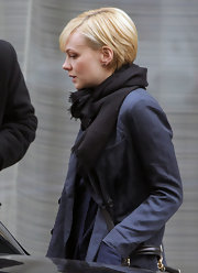 Carey Mulligan bundled up in a classic black scarf for leaving her hotel.