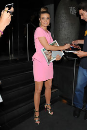 Carmen Electra looked fashionably fun, pairing a strappy pair of gold Louboutin heels with her pink peplum.