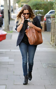 Caroline Flack dressed down her charming Peter Pan collared top and blazer with a pair of medium wash skinnies.