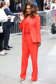 La La Anthony brought a jolt of color to the ABC Studios with this bright red Sandro pantsuit.