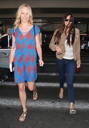 Candice Accola completed her breezy ensemble with a pair of gladiator sandals.