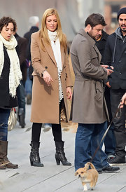 """So You Think You Can Dance"" hostess and fashionista Cat Deeley stayed on-trend in buckled mid-calf boots. The black leather boots looked fab with a classic camel coat."