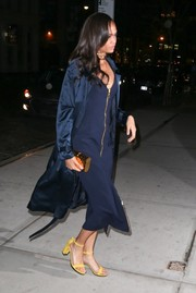 Joan Smalls layered a navy silk trenchcoat over her dress for added drama.