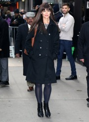 Katie Holmes was classic in a black Burberry London trenchcoat while headed to 'Good Morning America.'