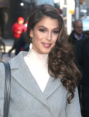 Iris Mittenaere paired her glamorous hairstyle with dangling silver earrings.