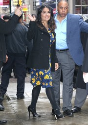 Salma Hayek was spotted outside the 'Good Morning America' studio wearing a black pea coat over a floral dress.
