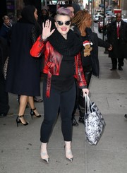 Kelly Osbourne stayed warm in edgy style with a red tie dye-effect leather jacket while headed to 'Good Morning America.'