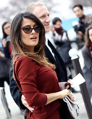 Salma Hayek attended the Balenciaga fall 2012 fashion show wearing her hair in long straight layers.