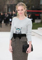 Kate Bosworth adorned her own sweater and textured skirt with a velvet bow for the Burberry fashion show.