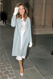 Sarah Jessica Parker looked ready for spring in a pastel blue coat and Grace Kelly-esque white gloves.