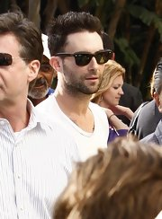 Adam showed off his shades while attending the LA Lakers game.