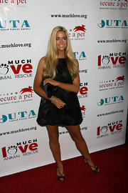 Denise's black, peep toe sandals and LBD show off her super toned and tanned legs.