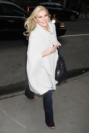 Elisha Cuthbert braved the cold of NYC in a slouchy white wool coat.
