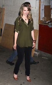 Bridgit Mendler paired her olive-and-black outfit with brown snakeskin peep-toes for a totally sophisticated look.
