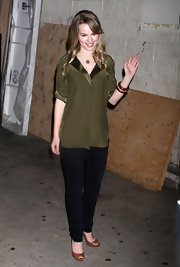 Bridgit Mendler was demure but oh-so-stylish in a olive loose blouse with satin cuffs and lapels.