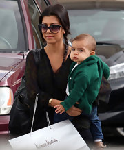 Kourtney Kardashian looked fabulous in a pair of oversized black sunglasses with a slight cateye shape.
