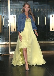 Blake Lively dressed down her gown with a blue denim jacket by Madewell.