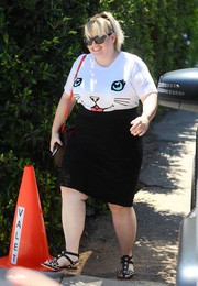 Rebel Wilson attended the Day of Indulgence Summer Party wearing a cute kitty T-shirt.