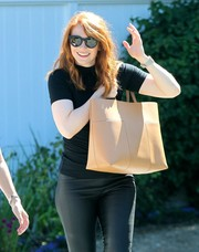 Bryce Dallas Howard styled her all-black outfit with an oversized beige tote for the Day of Indulgence Summer Party.