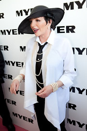 Liza Minnelli played with pearls during the Victoria Derby wearing a layered bracelet and necklace.