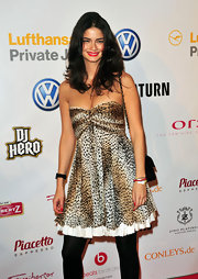 Shermine keeps it flirty in a leopard print strapless party dress.