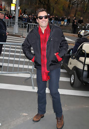 Jimmy stays warm in New York in a festive red plaid scarf.