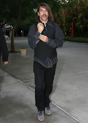 Anthony added a casual vibe to his look with suede lace-up sneakers.