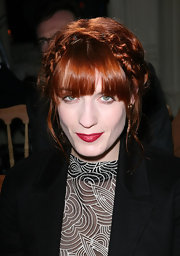 Florence Welch pulled her tresses up in a braided bun at the YSL fashion show.