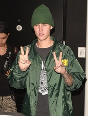 Justin Bieber stayed warm with a green knit beanie by Yea.Nice while attending Kendall Jenner's 20th birthday party.