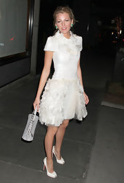 Blake Lively was a vision in white wearing square toed platform Lolo 69 pumps.