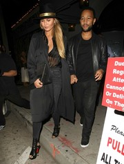 Chrissy Teigen sealed off her edgy look with open-toe ankle boots by Christian Louboutin.