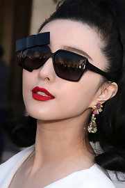 Fan Bingbing wore decadent gemstone earrings at the Dior fashion show.