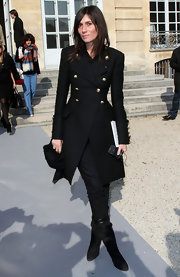 Emmanuelle Alt attended the Dior Fashion Show in a pair of sleek suede pointy boots.