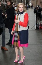 Elisabeth Moss left 'The View' looking vibrant in a color-block wool coat teamed with a patterned scarf and a pink dress.