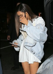 Kim Kardashian was tomboy-chic in a faded denim jacket layered over a loose tee while out at the Nice Guy.