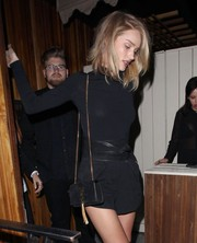 Rosie Huntington-Whiteley accentuated her tiny waist with an oversized black suede belt by Isabel Marant.