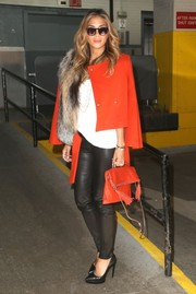 Nicole Scherzinger matched her jacket with a tasseled red bag.