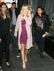 Lauren Bushnell arrived for her 'Good Morning America' appearance wearing a pale-pink duster over a purple lace dress.